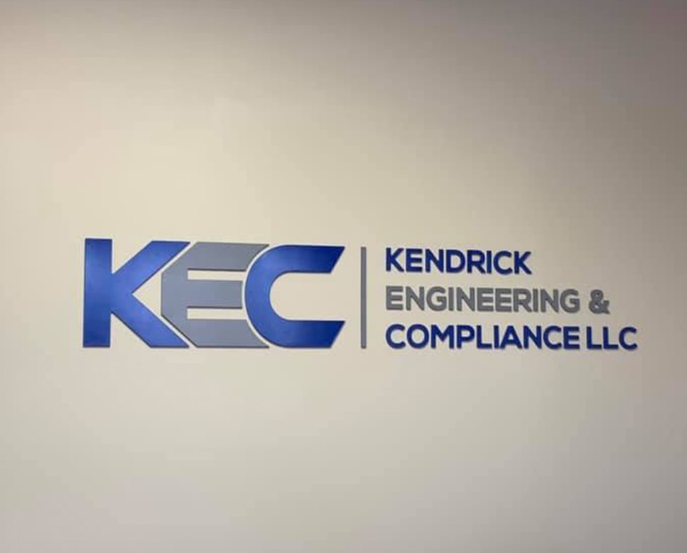 Kendrick Engineering & Compliance LLC signage on wall