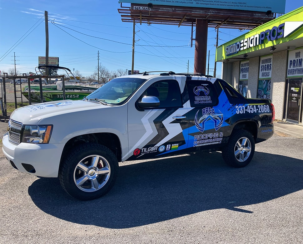 Roofing and Reconstruction vehicle wrap